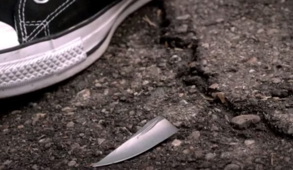 tennis shoe and knife blade