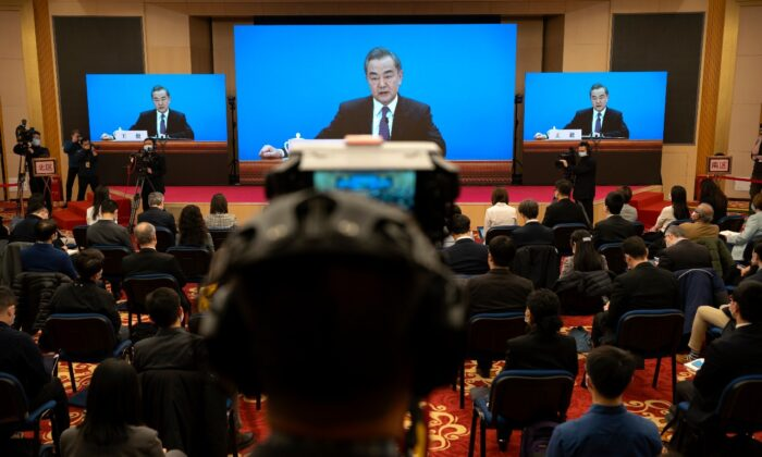 Chinese Foreign Minister Wang Yi speaks during a remote video press conference held on the sidelines of the annual meeting of China's National People's Congress in Beijing, on March 7, 2021. (Mark Schiefelbein/AP Photo)