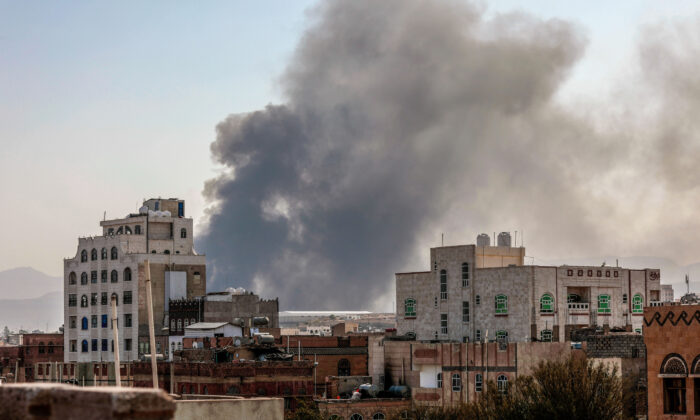 Smoke rises after Saudi-led airstrikes on an army base in Sanaa, Yemen, Sunday, Mar. 7, 2021. (AP Photo/Hani Mohammed)