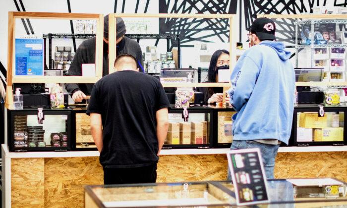 Customers shop for marijuana products at Catalyst Cannabis Dispensary in Santa Ana, Calif., on Feb. 18, 2021. (John Fredricks/The Epoch Times)
