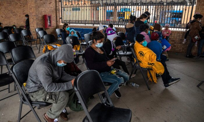 Illegal immigrant families wait for their bus at a bus station in Brownsville, Texas, before traveling to meet relatives or sponsors on March 2, 2021. (Sergio Flores/AFP/Getty Images)