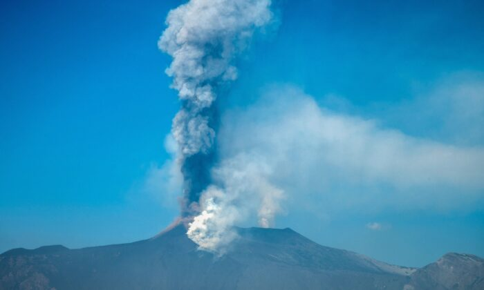A general view taken from Giarre shows the Mount Etna volcano spewing smoke north of Catania, Sicily, on March 4, 2021. (Giovanni Isolino/AFP via Getty Images)