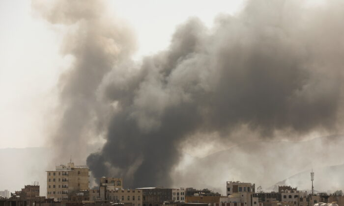 Smoke billows from the site of Saudi-led air strikes in Sanaa, Yemen, on March 7, 2021. (Khaled Abdullah/Reuters)