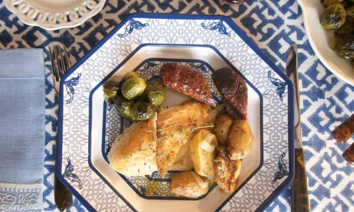 Roasting hot Italian sausages along with the chicken adds both flavor and bulk. (Victoria de la Maza)