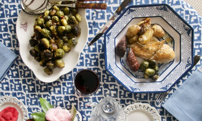This classic menu stars a dressed-up roast chicken with potatoes and spicy sausages. (Victoria de la Maza)