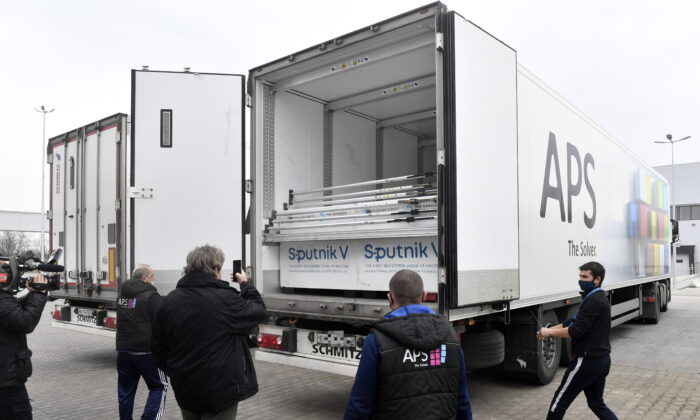 Boxes of Sputnik V vaccines are unloaded from a truck at a warehouse of Hungaropharma, a Hungarian pharmaceutical wholesale company, in Budapest, Hungary, on March 4, 2021. (Zoltan Mathe/MTI via AP)