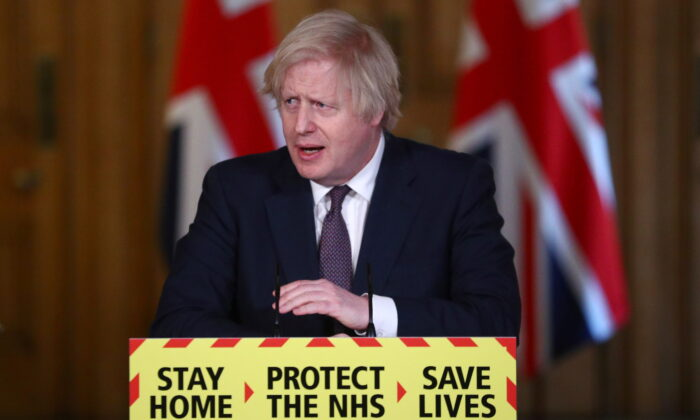 UK Prime Minister Boris Johnson attends a virtual COVID-19 news conference at 10 Downing Street in London, on March 8, 2021. (Hannah McKay - WPA Pool/Getty Images)