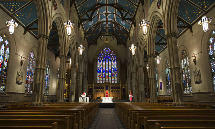 Cardinal Thomas Collins delivers at online Good Friday service in an empty St. MichaelÕs Cathedral in Toronto, Canada, on April 10, 2020.  (Nathan Denette/The Canadian Press)