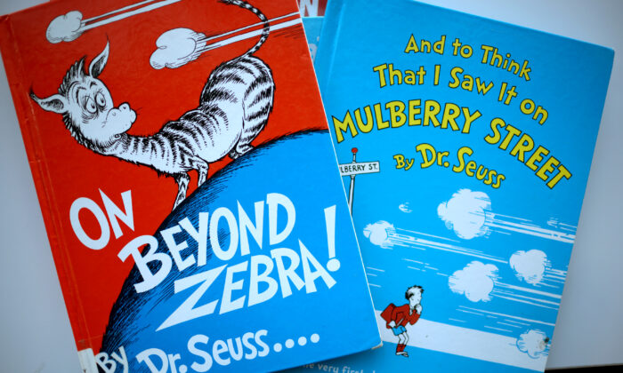 """Two of six titles by Theodor Seuss Geisel, aka Dr. Seuss—""""On Beyond Zebra!"""" and """"And to Think That I Saw it on Mulberry Street""""—that will no longer be printed because they are considered politically incorrect, at the Chinatown Branch of the Chicago Public Library in Chicago, on March 2, 2021. (Scott Olson/Getty Images)"""