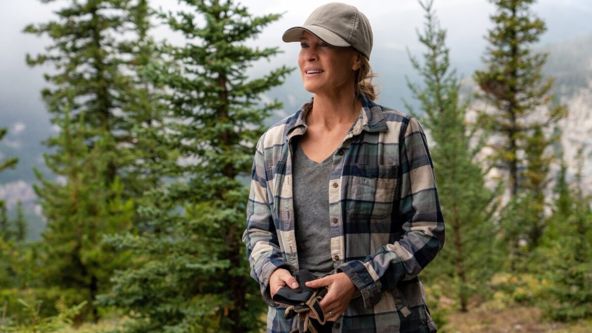 woman in plaid shirt and hat in Land