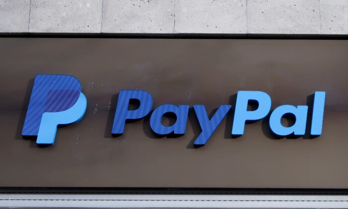 The PayPal logo is seen at an office building in Berlin, Germany, on March 5, 2019. (Fabrizio Bensch/Reuters)