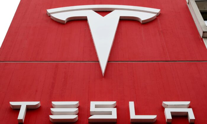 The logo of car manufacturer Tesla is seen at a branch office in Bern, Switzerland, on Oct. 28, 2020. (Arnd Wiegmann/Reuters)