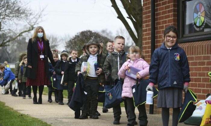 Children line up to enter a Primary Academy in Shipdham, England on March 8, 2021. (Joe Giddens/PA via AP)