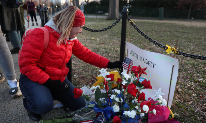 Melody Black, from Minnesota, becomes emotional as she visits a memorial setup near the U.S. Capitol building for Ashli Babbitt who was killed in the building the day prior, in Washington on Jan. 7, 2021. (Joe Raedle/Getty Images)