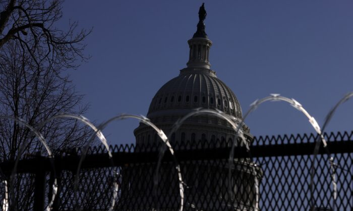 Razor wire is attached to the top of temporary fencing as the U.S. Capitol is seen in the background, in Washington on March 4, 2021. (Alex Wong/Getty Images)