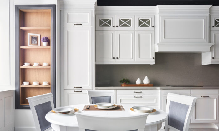 Wood cabinets are prone to all sorts of grease, grime, and gunk from simply being in the kitchen.(Iglenas/Shutterstock)