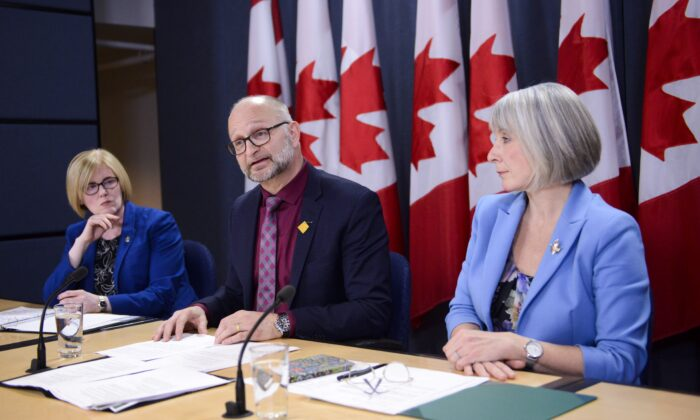 (L–R) Disability Inclusion Minister Carla Qualtrough, Justice Minister David Lametti, and Health Minister Patty Hajdu announce new legislation that would expand access to medically assisted dying, in Ottawa on Feb. 24, 2020. (The Canadian Press/Sean Kilpatrick)