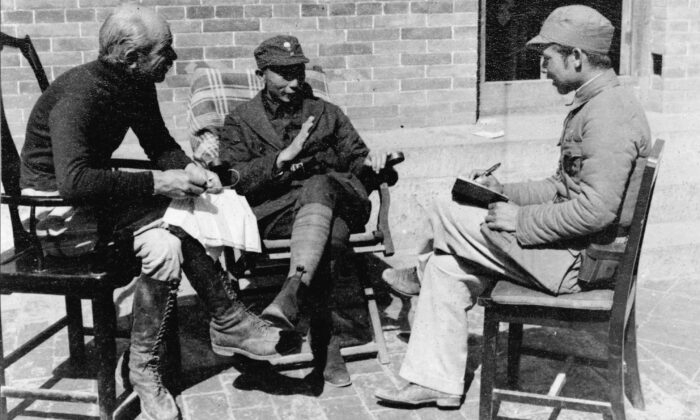 A meeting between Dr. Norman Bethune (L) and Nieh Jung-chen (C), Commander-in-Chief of the Chin-Ch'a-Chi Border Region, in China in 1938. (National Archives of Canada/CP Photo)