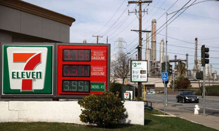 Gas prices are displayed at a 7-11 gas station across from the Shell refinery in Martinez, Calif., on March 3, 2021. (Justin Sullivan/Getty Images)