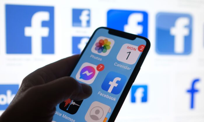 A Facebook App logo displayed on a smartphone in Los Angeles on March 1, 2021. (Chris Delmas/AFP via Getty Images)