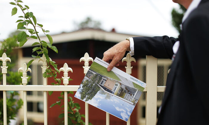 A prospective buyer looks at a property before the home auction for a four-bedroom house on Feb. 14, 2015 in Blacktown, Australia. (Mark Metcalfe/Getty Images)