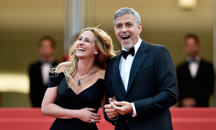 Actors Julia Roberts and George Clooney attend the 69th annual Cannes Film Festival at the Palais des Festivals in Cannes, France.  (Pascal Le Segretain/Getty Images)