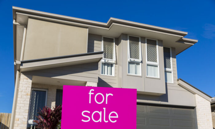 Property sales signage is displayed in North Lakes on June 10, 2016 in Brisbane, Australia. (Glenn Hunt/Getty Images)