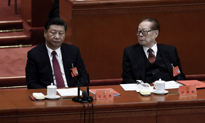 Chinese leader Xi Jinping (L) and his predecessor Jiang Zemin (R) attend the closing of the CCP's 19th Congress at the Great Hall of the People in Beijing, China on Oct. 24, 2017. (Wang Zhao/AFP via Getty Images)