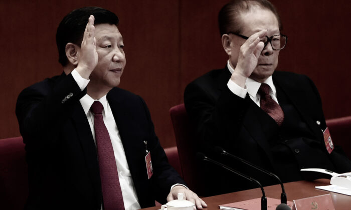 Chinese leaser Xi Jinping (L) raises his hand to vote for the reports with China's former leader Jiang Zemin at the closing of the 19th Communist Party Congress at the Great Hall of the People in Beijing on Oct. 24, 2017. (Greg Baker/AFP via Getty Images)