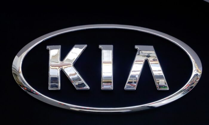 A KIA logo is displayed on a sign at the 2019 Pittsburgh International Auto Show in Pittsburgh, Pa., on Feb. 14, 2019. (Gene J. Puskar/AP Photo)