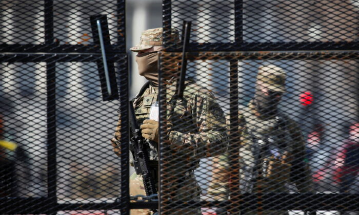 National Guard soldiers stand guard behind a security fence near the U.S. Capitol in Washington on March 4, 2021. (Jim Urquhart/Reuters)