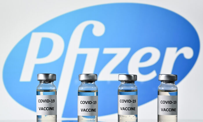 Vials with COVID-19 vaccine stickers attached, with the logo of U.S. pharmaceutical company Pfizer, on Nov. 17, 2020. (Justin Tallis/AFP via Getty Images)