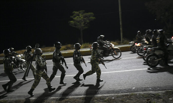 Security forces take part in a military drill to mark the eighth death anniversary of President Hugo Chavez in Caracas, Venezuela, on March 5, 2021. (Matias Delacroix/AP Photo)