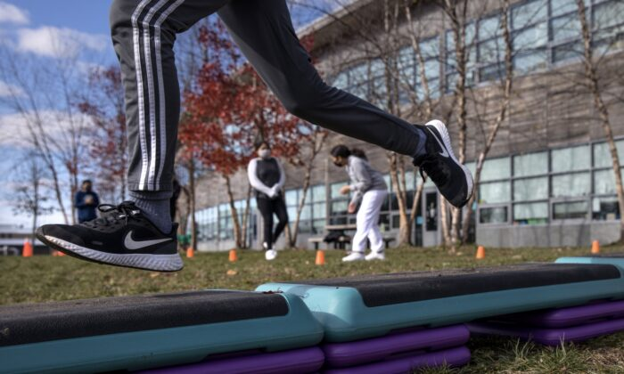 Seventh graders run through an obstacle course while getting exercise outside at Rogers International School in Stamford, Connecticut, on Nov. 24, 2020. (John Moore/Getty Images)