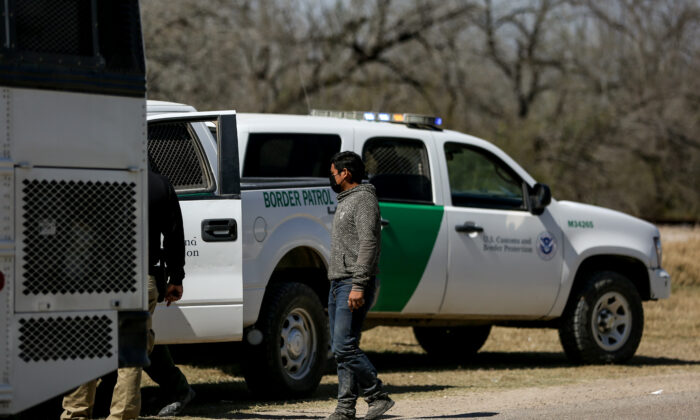 Border Patrol agents apprehend a busload of illegal immigrants in Penitas, Texas, on March 10, 2021. (Charlotte Cuthbertson/The Epoch Times)