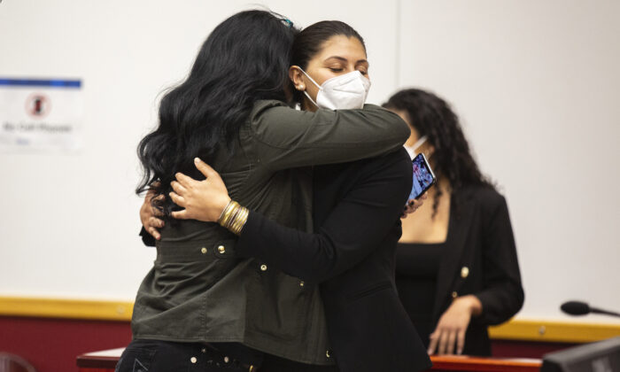 Des Moines Register Reporter Andrea Sahouri hugs her mom after being found not guilty at the conclusion of her trial, at the Drake University Legal Clinic, in Des Moines, Iowa, on March 10, 2021. (AP Photo/The Des Moines Register, Kelsey Kremer)