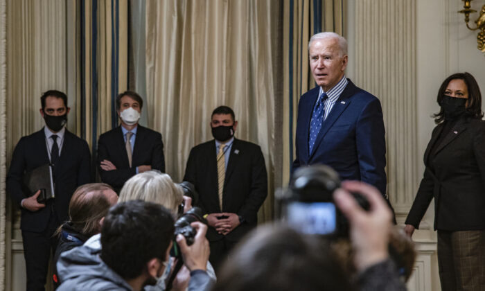 President Joe Biden stops to answer questions from reporters after speaking in the State Dining Room with Vice President Kamala Harris behind him following the passage of the American Rescue Plan in the U.S. Senate at the White House in Washington, on March 6, 2021. (Samuel Corum/Getty Images)