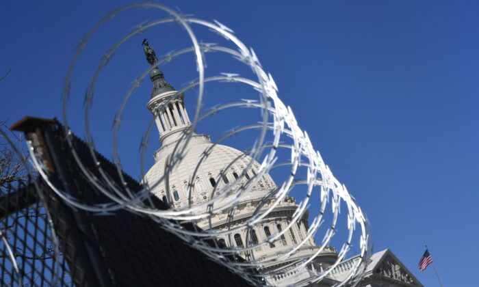 Razor wire is seen on fencing near the US Capitol Building on Capitol Hill in Washington, on March 3, 2021. (Eric Baradat/AFP via Getty Images)