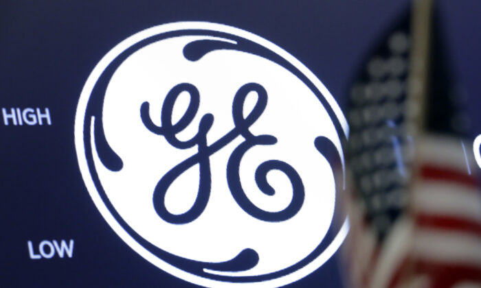 The General Electric logo appears above a trading post on the floor of the New York Stock Exchange in New York City, on June 28, 2018. (Richard Drew/AP Photo)
