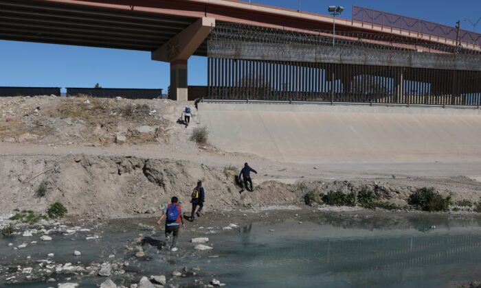 Illegal aliens cross the Rio Bravo to get to El Paso, Texas, from Ciudad Juarez, Chihuahua state, Mexico, on Feb. 5, 2021. (Herika Martinez/AFP via Getty Images)