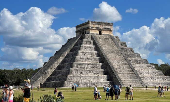Tourists wearing at Chichen Itza archaeological site in Mexico on March 5, 2021. (Daniel SLIM/AFP via Getty Images)