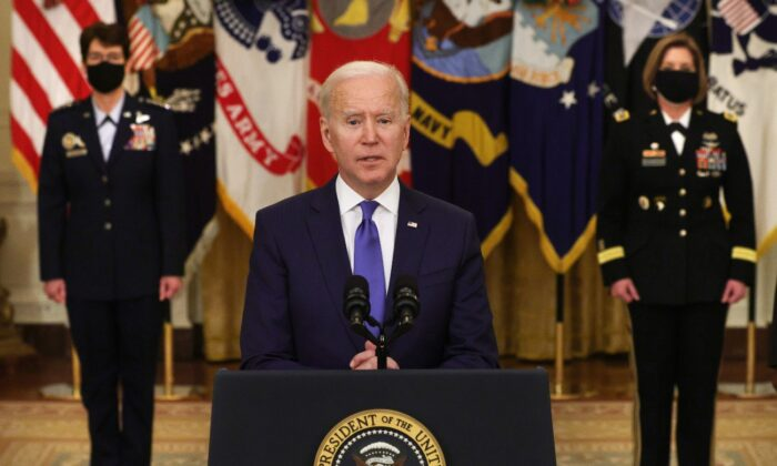 President Joe Biden delivers remarks as Air Force General Jacqueline Van Ovost (L) and Army Lieutenant General Laura Richardson listen during an announcement at the East Room of the White House in Washington, on March 8, 2021. (Alex Wong/Getty Images)