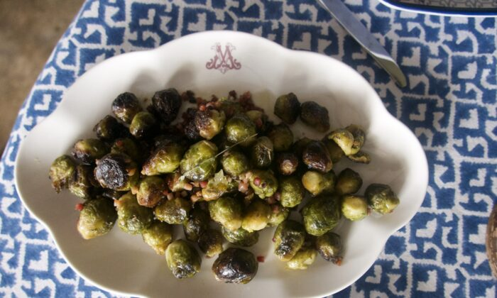 A sprinkling of chopped pancetta adds saltiness and smokiness to these simply roasted sprouts. (Victoria de la Maza)