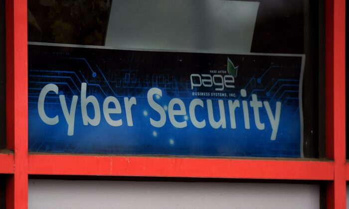 """A """"Cyber Security"""" sign is displayed in the window of a computer store in Arlington, Virginia, on Dec. 18, 2020. (Olivier Douliery/AFP via Getty Images)"""