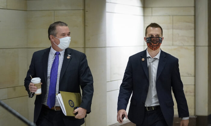 Rep. Jared Golden, right, walks with Rep. Don Bacon (R-Neb.) in Washington on May 28, 2020. (Drew Angerer/Getty Images)