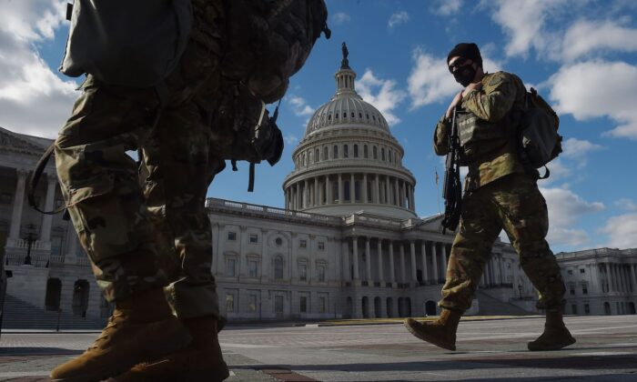 National Guard soldiers patrol the U.S. Capitol grounds on Capitol Hill in Washington on March 6, 2021. (Olivier Douliery/AFP via Getty Images)