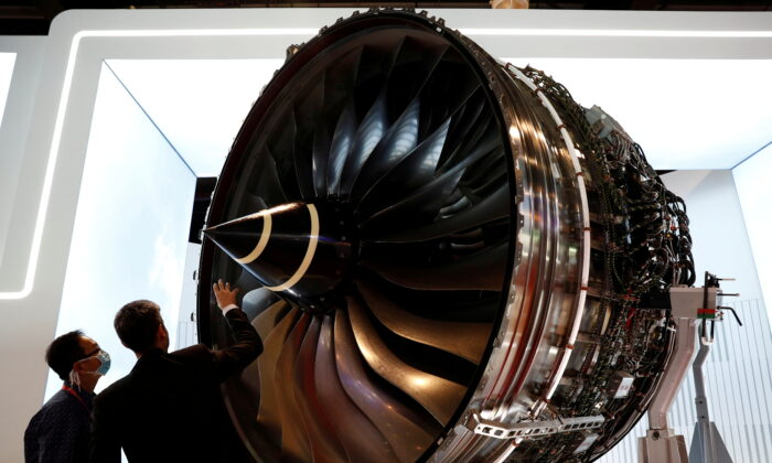 People look at Rolls Royce's Trent Engine displayed at the Singapore Airshow in Singapore, on Feb. 11, 2020. (Edgar Su/Reuters)