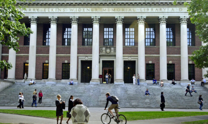 Students pass in front of Harvard's Widener Library in Cambridge, Massachusetts, on Oct. 10, 2003. (William B. Plowman/Getty Images)