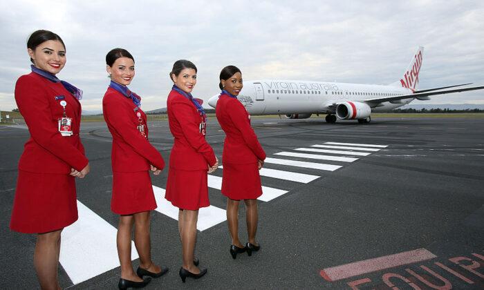 Virgin Australia cabin crew greet the chartered Virgin Australia flight as it arrives at Hobart International Airport  on November 13, 2014 in Hobart, Australia. (Graham Denholm/Getty Images)