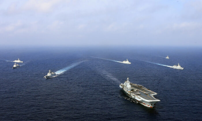 This undated photo taken in April 2018 shows China's sole operational aircraft carrier, the Liaoning (front), sailing with other ships during a drill at sea. (-/AFP via Getty Images)